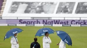 Umpires hold umbrellas as rain delayed start of the first day of the 1st cricket Test match between England and West Indies, at the Ageas Bowl in Southampton, England, Wednesday July 8, 2020. (Adrian Dennis/Pool via AP)(AP)