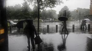 Heavy rain was falling in New York City on Friday afternoon as the centre of the storm moved northward toward upstate New York and western New England.(AP Photo)