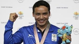 Jitu Rai of India poses with his gold medal in the men's 10m Air Pistol final at the Belmont Shooting Centre during the 2018 Commonwealth Games in Brisbane.(AP)