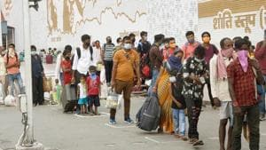 Passengers are in queue outside of Patna Junction during the total lockdown to curb the spread of Coronavirus disease. Bihar India on Saturday.