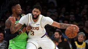 Minnesota Timberwolves forward Robert Covington (33) guards Los Angeles Lakers forward Anthony Davis (3) as he moves to the basket in the first half of the game at Staples Center.(USA TODAY Sports)