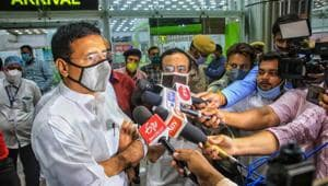 Senior Congress leader Randeep Surjewala speaks to media after arriving at Jaipur airport on Sunday.(PTI Photo)