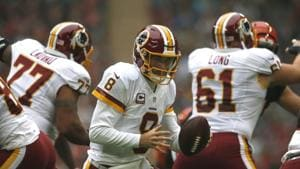 Kirk Cousins #8 of the Washington Redskins looks to hand off the ball during the NFL International Series game against the Cincinnati Bengals at Wembley Stadium on October 30, 2016 in London, England.(Getty Images)