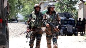 Army soldiers stand near encounter site in Sirhama Anantnag district south Kashmir on Monday. Two Jaish e Mohammad terrorists were killed in an encounter in South Kashmir.(ANI Photo)