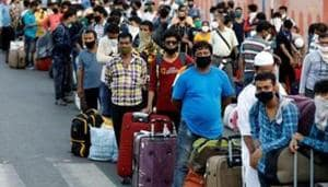 Migrant workers and their families wait in lines outside a railway station to board a train to their home state West Bengal, after authorities eased lockdown restrictions that were imposed to slow the spread of the coronavirus disease (Covid-19) in Ahmedabad on June 18, 2020.(Reuters File Photo)