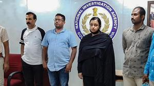 Kerala gold smuggling case accused Swapna Suresh and Sandeep Nair (both in middle) after they were arrested by the National Investigation Agency in Bengaluru, Karnataka on Saturday.(PTI Photo)