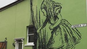 Alice in Wonderland mural in Bedminster, Bristol.(Instagram @stewystencils)
