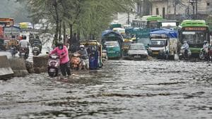 Delhi received this season's first spell of heavy rains on Sunday which submerged low-lying areas in waist-deep water.(Sanchit Khanna/ Hindustan Times)