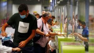 British tourists returning to UK, check in their luggage, as Britain imposed a two-week quarantine on all travellers arriving from Spain, following the coronavirus disease (Covid-19) outbreak.(REUTERS)