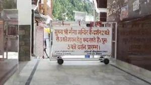 Barricade put up outside the main gate of Gangotri shrine in Uttarkashi district on Tuesday.(HT Photo)