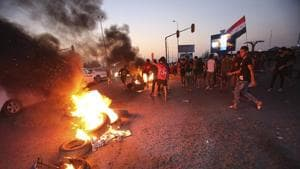 Protesters burn tires during a demonstration demanding better public services and jobs in Basra, southeast of Baghdad, Iraq on Monday.(AP Photo)