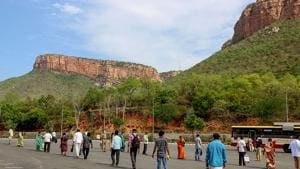 Employees queue to board a bus at foothill of Lord Venkateswara temple at Tirumala on the reopening day of the shrine, during the ongoing COVID-19 nationwide lockdown, in Tirupati.(PTI)