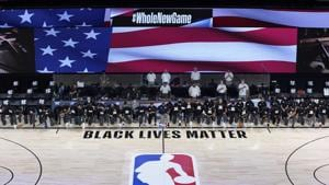 Members of the New Orleans Pelicans and Utah Jazz kneel together around the Black Lives Matter logo on the court during the national anthem before the start of an NBA basketball game.(USA TODAY Sports)