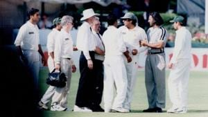 Calm down: Pakistan's Inzamam Ul-Haq; wearing cap at right-centre; is restrained by officials during Sahara Cup cricket fracas.(Getty Images)