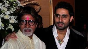 Amitabh Bachchan (L) and his son Abhishek Bachchan pose for a picture during a party.(REUTERS)