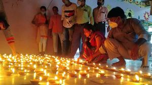 People light earthen lamps on the eve of the foundation laying ceremony of Ram Temple in Ayodhya on Tuesday.(ANI)