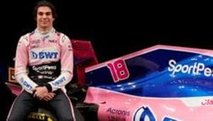 SportPesa Racing Point F1 Team driver Lance Stroll poses after unveiling the team's new car livery at a pre-season launch event at the Canadian International AutoShow in Toronto, Ontario, Canada, February 13, 2019.(REUTERS)