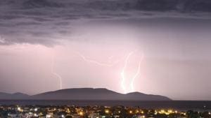 Lightnings strike over the island of Evia as seen from the town of Artemida, Greece(REUTERS)