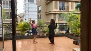 Renee and Alisah dance in rain.