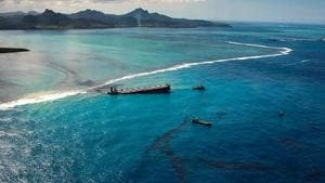 An aerial photo shows oil leaking from the MV Wakashio, a bulk carrier ship that ran aground off the coast of Mauritius.