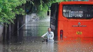 Waist-deep flooding brings parts of Capital to its knees