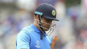 India's MS Dhoni reacts as he leaves the field after being dismissed by New Zealand's Martin Guptill.(AP)