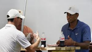 Tiger Woods, right, has lunch with Rory McIlory, left, during the third round of the Northern Trust golf tournament at TPC Boston, Saturday, Aug. 22, 2020, in Norton, Mass. (AP Photo/Charles Krupa)(AP)