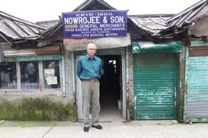 Parvez Nowrojee at the 160-year-old Nowrojee & Sons General Store in McLeodganj town of Himachal Pradesh. He is from the sixth generation of the Parsi family and has sold the property after it became financially unviable to manage.(HT Photo)