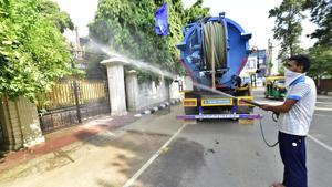 MC workers sanitising the Maya Nagar area in Ludhiana on Monday.(Gurpreet Singh/HT)