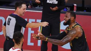 Referee David Guthrie (16) points to Los Angeles Lakers' LeBron James, right, during the third quarter of Game 4 of an NBA basketball first-round playoff series against the Portland Trail Blazers, Monday, Aug. 24, 2020, in Lake Buena Vista, Fla. (Kevin C. Cox/Pool Photo via AP)(AP)