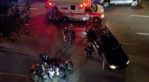 Medics and police personnel (bottom) surround the victim of a shooting in Portland, Oregon, US August 29, 2020.(Courtesy of Sergio Olmos via Reuters)