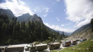 An Indian army convoy moves on the Srinagar- Ladakh highway at Gagangeer, northeast of Srinagar, India.(AP)