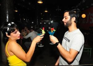Young people clink cocktail glasses at Social in Chandigarh's Sector 7 on Wednesday.(Ravi Kumar/Hindustan Times)