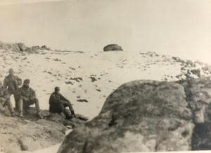 Some men from the patrol at Billi Post, with the author wearing a turban and snow goggles (sitting). A Chinese bunker can be seen in the background.(Courtesy: Author's own)