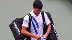 Novak Djokovic walks off after being disqualified(Getty Images)
