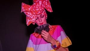 A model holds a face mask prior the fashion show of Spanish designer Agatha Ruiz de la Prada during the Mercedes-Benz Fashion Week in Madrid, Spain, Thursday, Sept. 10, 2020. The Spanish fashion week takes place from 10 to 13 September under new security measures and social distance guidelines due the coronavirus pandemic.(AP)