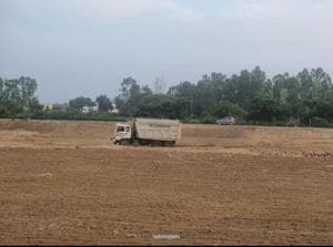 Land being levelled at the site of the Guru Nanak Colony on Adamwal road near Hoshiarpur on Friday.(HT photo)