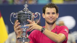 New York: Dominic Thiem, of Austria, holds up the championship trophy after defeating Alexander Zverev, of Germany, in the men's singles final of the US Open tennis championships, Sunday, Sept. 13, 2020, in New York.AP/PTI(AP14-09-2020_000010A)(AP)