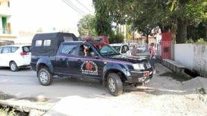 A police vehicle on the premises of former minister Choudhary Lal Singh in Kathua on Tuesday.(Sourced)