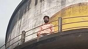 The councillor climbed an overhead tank at Jal Sansthan in Haldwani, Nainital district.(HT Photo)