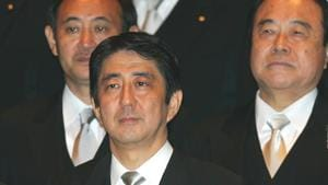 In this Sept. 26, 2006, file photo, then newly-appointed Japanese Prime Minister Shinzo Abe, front row, poses with his Cabinet members after an attestation ceremony for his Cabinet at the Imperial Palace in Tokyo.(AP)