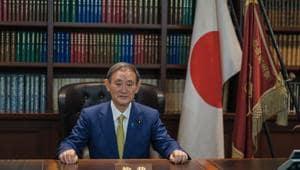 File Photo of Yoshihide Suga (Nicolas Datiche/Sipa Press/Bloomberg)