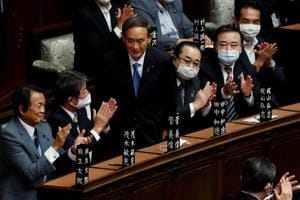 Japan's newly-elected Prime Minister Yoshihide Suga stands as he was chosen as new prime minister at the Lower House of Parliament in Tokyo, Japan (REUTERS/Kim Kyung-Hoon)