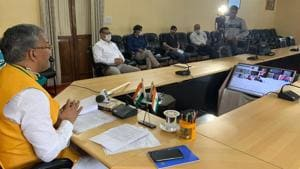 Chief minister TS Rawat addressing a press conference virtually in Dehradun on Friday. He said the Mahakumbh would be held on schedule next year, but in a restricted manner.(Sourced)