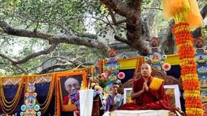 File photo: Tibetan spiritual leader Ogyen Trinley Dorje, the 17th Karmapa, offers prayers at the Mahabodhi temple in Bodhgaya.(AFP)