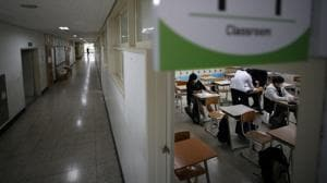 High school students prepare for a class amid the coronavirus disease (Covid-19) pandemic at a high school in Seoul, South Korea.(Reuters)