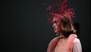 A model presents a creation during fashion week in Milan, Italy, September 23, 2020.(REUTERS)