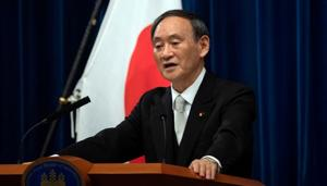 FILE PHOTO: Yoshihide Suga speaks during a news conference following his confirmation as Prime Minister of Japan in Tokyo, Japan September 16, 2020 (Carl Court/Pool via REUTERS/File Photo)