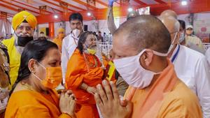 Uttar Pradesh Chief Minister Yogi Adityanath being greeted by BJP leader Uma Bharti during the function ahead of the inception of Bhoomi Pujan for the construction of Ram Temple, in Ayodhya.(PTI)