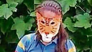 Students created masks of endangered animals like tiger during the event.(HT)